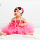 Baby girl studio portrait session with a beautiful tutu dress and pearls