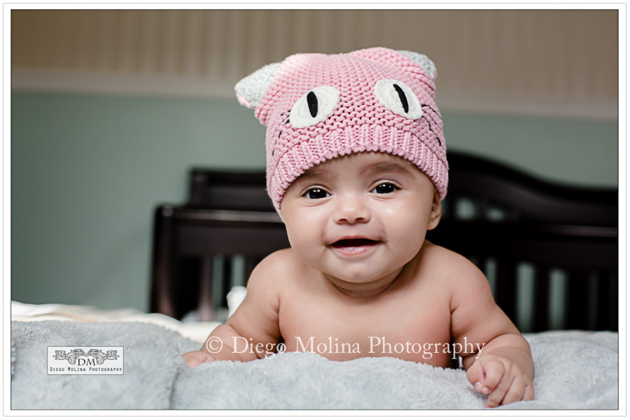 Lovely smiley 4 month old baby girl portrait session on location